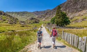 Two female hikers ascending the Watkin Path towards the summit of Snowdon.
