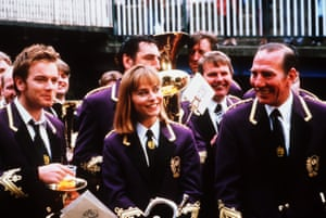Fitzgerald with Ewan McGregor (left) and Pete Postlethwaite in the 1996 film Brassed Off.