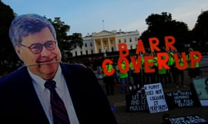 A cardboard cutout of US attorney general William Barr is seen as protesters hold signs outside the White House.