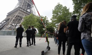 Police prevent tourists from entering the area surrounding the Eiffel Tower