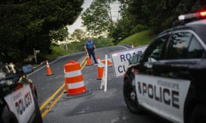 A New Jersey police officer closes a road where a tornado touched down on 29 May 2019 in Stanhope, New Jersey.