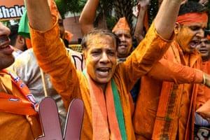 BJP supporters celebrate on vote results day in Delhi.