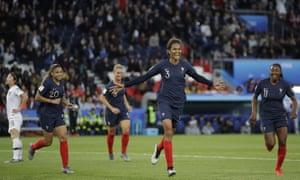 Wendie Renard, middle, celebrates after scoring France's second.