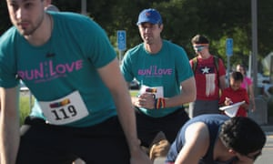 Beto O'Rourke stretches before the Pride Fest Fun Run 5K in Des Moines, Iowa on Saturday.