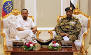 Ethiopia's Prime Minister Abiy Ahmed (L) meets with the chief of Sudan's ruling military council General Abdel Fattah al-Burhan in Khartoum on Friday.