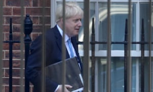 boris johnson behind railings