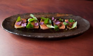 'A long plate of tuna tataki comes swimming in wakami oil and house soy.'
