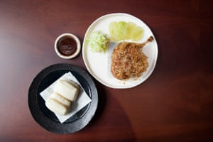 'Duck legs caked in bonito and served with a bao bun' at Lucky Cat Restaurant, Mayfair, London.