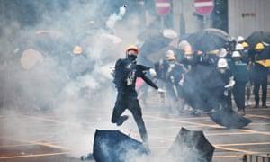 Protester throws teargas canister