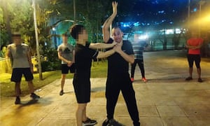 Hong Kongers attend free self-defence classes in a park.