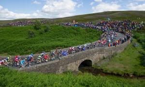 The peloton crosses Grinton Moor Bridge during the Grand Départ to the 2014 Tour de France.