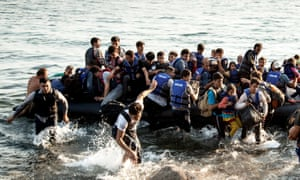 A boat dangerously overloaded with refugees lands near Molyvos on the Greek island of Lesbos, July 2015.