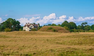 One of the burial mounds and Tranmer House, the home of Edith Pretty who instigated the Sutton Hoo digs in 1939.