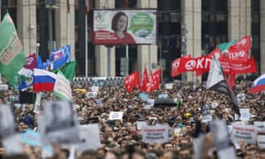 People attend a rally to demand authorities allow opposition candidates to run in a local election in Moscow.