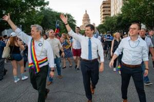 Mayor Steve Adler, presidential candidate Pete Buttigieg and his husband Chasten Buttigieg attend the Austin Pride Parade.