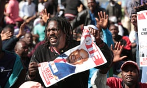 Protestors take part in a march organised by the Movemnet for Democratic Change.
