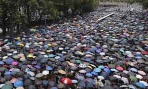 Protesters faced heavy rain during Sunday's rally.