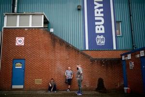 Supporters outside Bury's Gigg Lane ground.