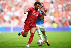 Zinchenko battles for possession with Salah.