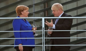 Merkel and Johnson enjoying a drink on the terrace at the Chancellery.