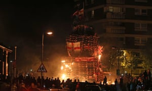 Crowds watch as a bonfire is lit in the New Lodge area of Belfast on Thursday night.