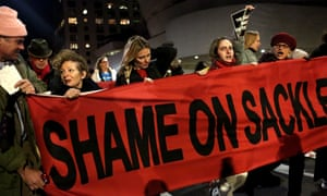 Art photographer and activist Nan Goldin (left) and her organization, P.A.I.N. (Prescription Addiction Intervention Now,) lead a protest out of the Solomon R. Guggenheim Museum in Manhattan, New York, against its funding by the members of the Sackler family, the owners of Oxycontin manufacturer Purdue Pharma.