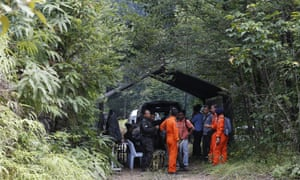 Search and rescue teams at a temporary operation shelter near the resort where Nora went missing