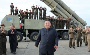 Kim Jong-un smiles after the test firing of Saturday's missile system.