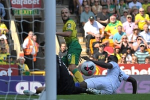 Teemu Pukki watches his shot beat goalkeeper Kepa Arrizabalaga.