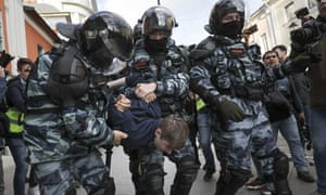 Police detain a protester during the protest in Moscow on Saturday.