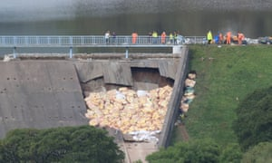 Emergency repairs to the damaged dam.
