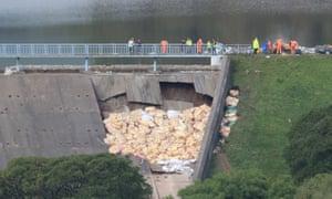 Emergency repairs to the damaged dam.
