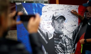 A Formula One fan signs a board of remembrance.