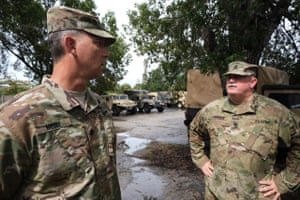Lieutenant Colonel Jeff Moore and Command Sergeant Major Tom Aycock of Florida Army National Guard discuss logistic preparations for Hurricane Dorian