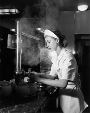 A waitress working hard behind the counter. Black and white image.