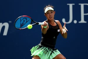 Qiang Wang of China returns a shot against Ashleigh Barty of Australia.