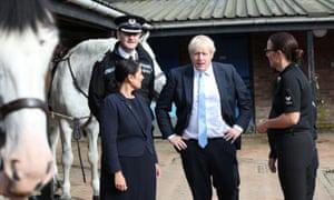 Boris Johnson and the home secretary, Priti Patel, visit West Yorkshire police's training centre.
